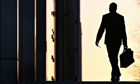 A worker arrives at his office in the Canary Wharf